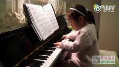 Child prodigy playing classical piano music